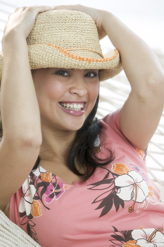 Lady holding straw hat